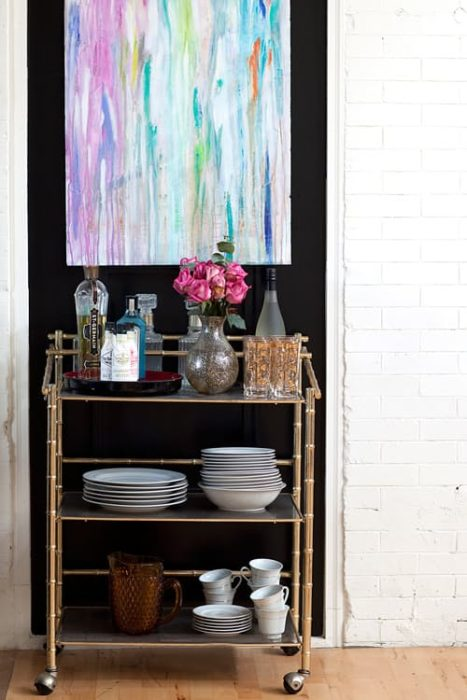 make-a-small-kitchen-storage-area-stand-out-with-dark-paint